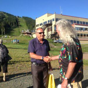Gordon Olsen (right) shakes hands with John Duncan.